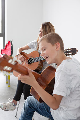 TYLOS Muzikos Studija gitaros pamokos